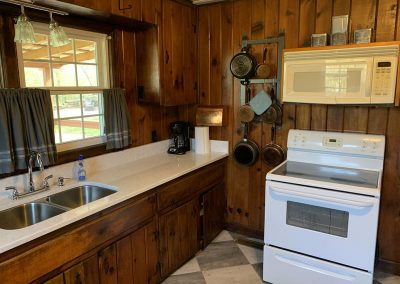Full size appliances and pot rack