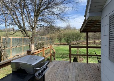 Grill and view of yard and side deck
