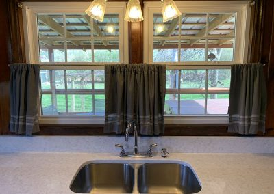 Sink with quartz counter top and view of backyard