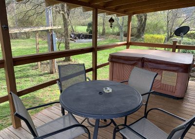 Tables, hot tub, and view of firepit